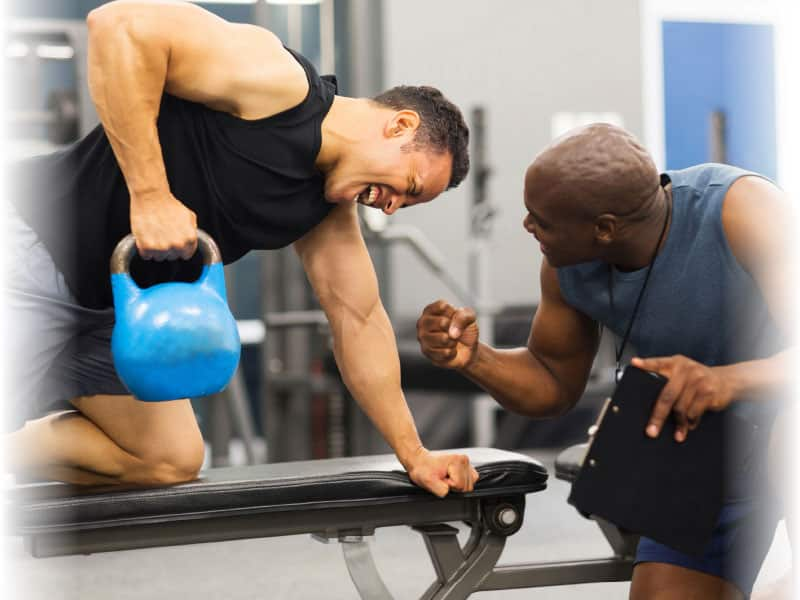 personal trainer encouraging client