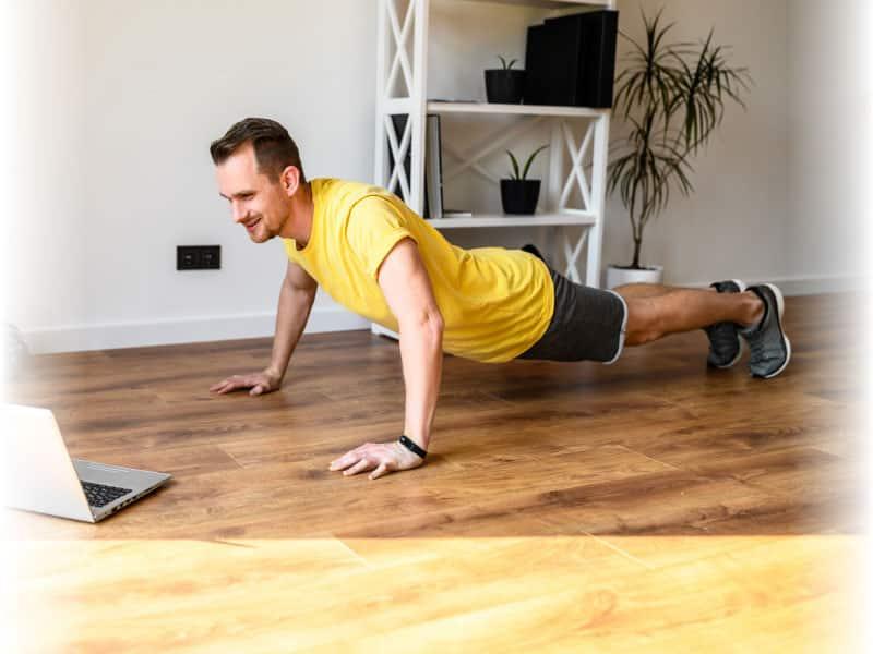 man doing push ups through virtual training