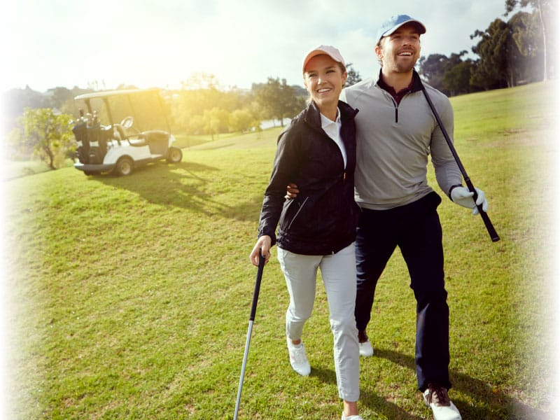 couple smiling playing golf
